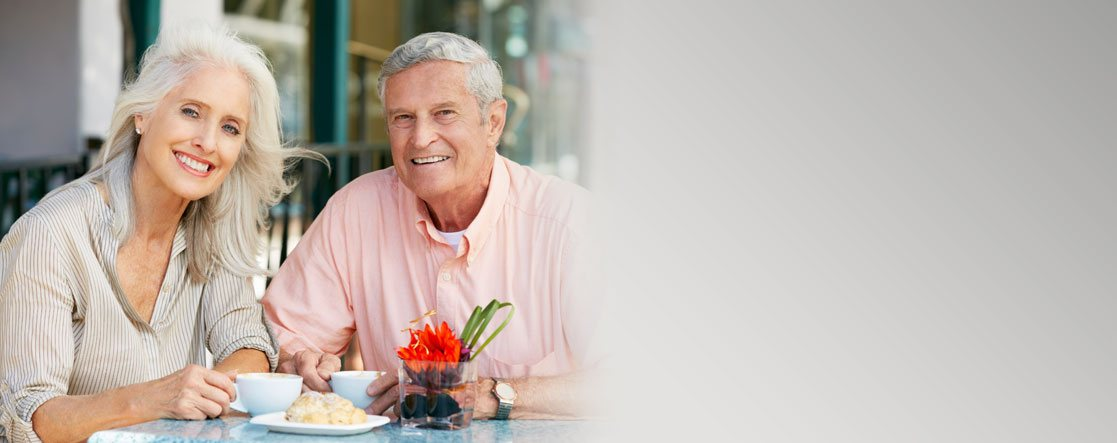 Restorative Dentistry and Elderly couple eating lunch and smiling